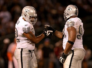 OAKLAND, CA - SEPTEMBER 14:  Richard Seymour #92 and Tommy Kelly #93 of the Oakland Raiders shake hands after a big play during their game against the San Diego Chargers on September 14, 2009 at the Oakland-Alameda County Coliseum in Oakland, California.