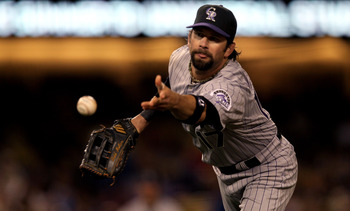 LOS ANGELES - MAY 8:  First baseman Todd Helton #17 of the Colorado Rockies flips the ball to first to force out Matt Kemp of the Los Angeles Dodgers to end the fifth inning on May 8, 2010 at Dodger Stadium in Los Angeles, California.  (Photo by Stephen D