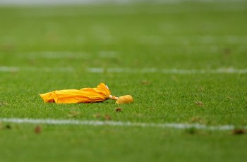 DENVER - SEPTEMBER 20:  A penalty flag lies on the turf as the Cleveland Browns face the Denver Broncos during NFL action at Invesco Field at Mile High on September 20, 2009 in Denver, Colorado. The Broncos defeated the Browns 27-6.  (Photo by Doug Pensin