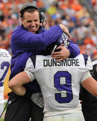 TAMPA, FL - JANUARY 1: Coach Pat Fitzgerald of the Northwestern Wildcats celebrates a touchdown catch by split back Drake Dunsmore #9 against the Auburn Tigers in the Outback Bowl January 1, 2010 at Raymond James Stadium in Tampa, Florida.  (Photo by Al M
