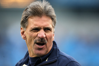 CHARLOTTE, NC - DECEMBER 26:  Head coach Dave Wannstedt of the Pittsburgh Panthers smiles before the start of their game against the North Carolina Tar Heels on December 26, 2009 in Charlotte, North Carolina.  (Photo by Streeter Lecka/Getty Images)