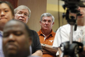 AUSTIN, TX - JUNE 15:  University of Texas at Austin football head coach Mack Brown listens as university officials announce the athletics programs will continue competing in the Big 12 Conference June 15, 2010 in Austin, Texas.  (Photo by Erich Schlegel/
