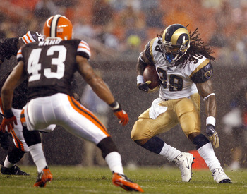 CLEVELAND - AUGUST 21:  St. Louis Rams #39 Steven Jackson runs by #43 T.J. Ward of the Cleveland Browns at Cleveland Browns Stadium on August 21, 2010 in Cleveland, Ohio.  (Photo by Matt Sullivan/Getty Images)