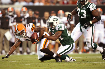CLEVELAND, OH - AUGUST 7:  Darrelle Revis #24 of the New York Jets tackles Donte Stallworth #18 of the Cleveland Browns during the first quarter of a preseason game at Cleveland Browns Stadium on August 7, 2008 in Cleveland, Ohio. The game was suspended d