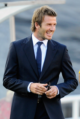 PASADENA, CA - AUGUST 07: David Beckham of Los Angeles Galaxy visits Real Madrid becnh before the start of their pre-season friendly soccer match on August 7, 2010 at the Rose Bowl in Pasadena, California. Real Madrid will travel back to Spain after the s