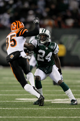EAST RUTHERFORD, NJ - JANUARY 03:  Chad Ochocinco #85 of the Cincinnati Bengals runs past Darrelle Revis #24 of the New York Jets in the second quarter at Giants Stadium on January 3, 2010 in East Rutherford, New Jersey.  (Photo by Al Bello/Getty Images)