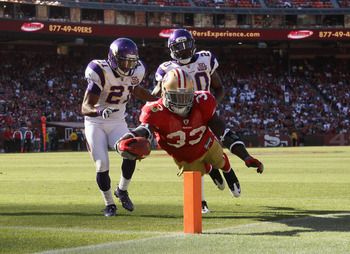 SAN FRANCISCO - AUGUST 22:  Anthony Dixon #33 of the San Francisco 49ers dives past Madieu Williams #20 and Asher Allen #21 of the Minnesota Vikings at Candlestick Park on August 22, 2010 in San Francisco, California.  (Photo by Ezra Shaw/Getty Images)