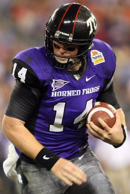 GLENDALE, AZ - JANUARY 04:  Quarterback Andy Dalton #14 of the TCU Horned Frogs runs the ball against the Boise State Broncos during the Tostitos Fiesta Bowl at the Universtity of Phoenix Stadium on January 4, 2010 in Glendale, Arizona.  (Photo by Christi