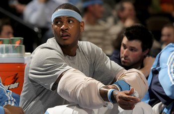 DENVER - DECEMBER 19:  Carmelo Anthony #15 of the Denver Nuggets ices his elbow as he sits on the bench against the Cleveland Cavaliers at the Pepsi Center on December 19, 2008 in Denver, Colorado.The Cavaliers defeated the Nuggets 105-88.  (Photo by Doug