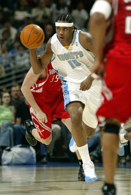 DENVER - APRIL 2:  Carmelo Anthony #15 of the Denver Nuggets takes off with a turnover against the Houston Rockets at the Pepsi Center on April 2, 2004 in Denver, Colorado. NOTE TO USER: User expressly acknowledges and agrees that, by downloading and/or u