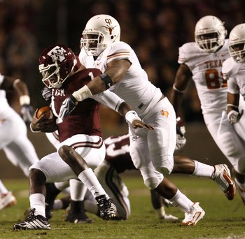 COLLEGE STATION, TX - NOVEMBER 26: Defensive tackle Kheeston Randall #91 of the Texas Longhorns sacks quarterback Jerrod Johnson #1 of the Texas A&M Aggies for a loss in the first half at Kyle Field on November 26, 2009 in College Station, Texas. The Long