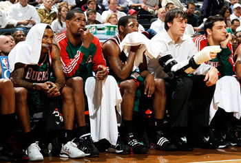 ATLANTA - APRIL 20:  (L-R) Brandon Jennings #3, Kurt Thomas #40, John Salmons #15, Andrew Bogut #6 and Carlos Delfino #10 of the Milwaukee Bucks look on from the bench in the final minute of their 96-86 loss to the Atlanta Hawks at Philips Arena on April