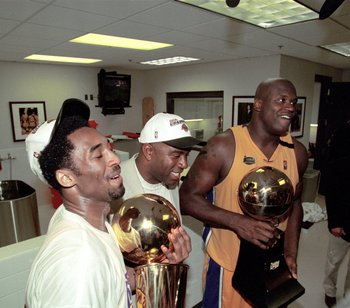 19 Jun 2000:  Kobe Bryant #8 and Shaquille O''Neal #34 of the Los Angeles Lakers hold the NBA Championship trophies with Magic Johnson after winning the NBA Finals Game 6 against the Indiana Pacers at the Staples Center in Los Angeles, California.  The La