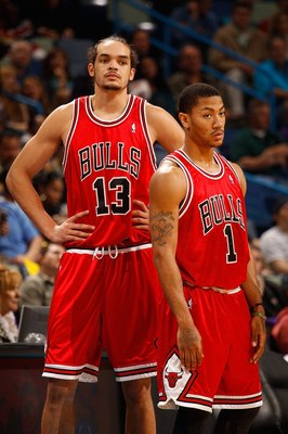 NEW ORLEANS - JANUARY 29:  Joakim Noah #13 and Derrick Rose #1 of the Chicago Bulls during the game against the New Orleans Hornets at the New Orleans Arena on January 29, 2010 in New Orleans, Louisiana.   NOTE TO USER: User expressly acknowledges and agr