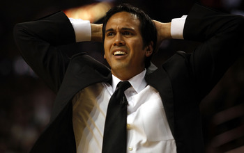 MIAMI - APRIL 23: Coach Erik Spoelstra of the Miami Heat reacts during a 100-98 loss to the Boston Celtics in Game Three of the Eastern Conference Quarterfinals during the 2010 NBA Playoffs at American Airlines Arena on April 23, 2010 in Miami, Florida. N