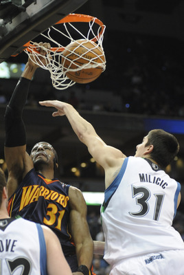MINNEAPOLIS, MN - APRIL 7: Chris Hunter #31 of the Golden State Warriors dunks against Darko Milicic #31 of the Minnesota Timberwolves in the first half during a basketball game at Target Center on April 7, 2010 in Minneapolis, Minnesota.  NOTE TO USER: