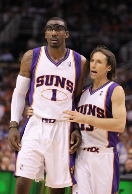 PHOENIX - APRIL 13:  Amar'e Stoudemire #1 and Steve Nash #13 of the Phoenix Suns walk upcourt during the NBA game against the Denver Nuggets at US Airways Center on April 13, 2010 in Phoenix, Arizona. The Suns defeated the Nuggets 123-101. NOTE TO USER: U