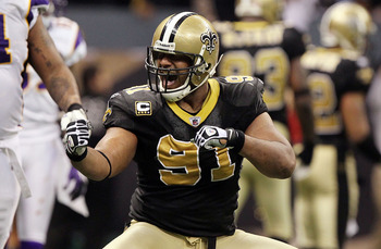 NEW ORLEANS - JANUARY 24:  Will Smith #91 of the New Orleans Saints reacts after a fumble in the fourth quarter against the Minnesota Vikings looks on during the NFC Championship Game at the Louisiana Superdome on January 24, 2010 in New Orleans, Louisian