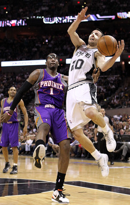 SAN ANTONIO - MAY 09:  Guard Manu Ginobili #10 of the San Antonio Spurs is fouled by Amar'e Stoudemire #1 of the Phoenix Suns in Game Four of the Western Conference Semifinals during the 2010 NBA Playoffs at AT&T Center on May 9, 2010 in San Antonio, Texa