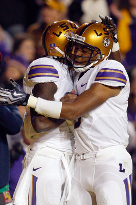 BATON ROUGE, LA - NOVEMBER 28:  Jordan Jefferson #9 and Brandon LaFell #1 of the Louisiana State University Tigers celebrate after a touchdown against the Arkansa Razorbacks at Tiger Stadium on November 28, 2009 in Baton Rouge, Louisiana.  (Photo by Chris