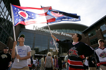 COLUMBUS, OH - JUNE 22:  Fans of the Columbus Blue Jackets wave flags prior to first round of the 2007 NHL Entry Draft outside of Nationwide Arena on June 22, 2007 in Columbus, Ohio.  (Photo by Jamie Sabau/Getty Images)