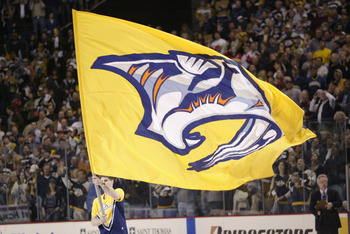 NASHVILLE - APRIL 13:  A Nashville Predators flag is paraded around the rink during a break in game four of the first round of the  2004 Stanley Cup playoffs against the Detroit Red Wings on April 13, 2004 at the Gaylord Center in Nashville, Tennessee. (P