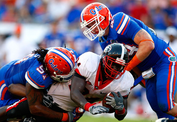 JACKSONVILLE, FL - OCTOBER 31:  Brandon Spikes #51 and Duke Lemmens #44 of the Florida Gators tackle Washaun Ealey #24 of the Georgia Bulldogs at Jacksonville Municipal Stadium on October 31, 2009 in Jacksonville, Florida.  (Photo by Kevin C. Cox/Getty Im