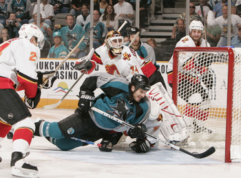 SAN JOSE, CA - MAY 9:  Mike Ricci #18 of the San Jose Sharks scores against Miikka Kiprusoff #34 of Calgary Flames during Game one of the 2004 NHL Western Conference Finals during the Stanley Cup Playoffs on May 9, 2004 at the HP Pavilion at San Jose in S