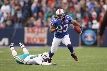 ORCHARD PARK, NY - NOVEMBER 29: Marshawn Lynch #23 of the Buffalo Bills runs past Sean Smith #24 of the Miami Dolphins at Ralph Wilson Stadium on November 29, 2009 in Orchard Park, New York. Buffalo won 31-14. (Photo by Rick Stewart/Getty Images)