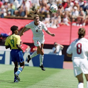 4 Jul 1999: Brandi Chastain #6 of Team USA jumps to head the ball during a Womens World Cup game against Team Brazil at the Stanford Stadium in Palo Alto, California. Team USA defeated Team Brazil 2-0. Mandatory Credit: Tom Hauck  /Allsport