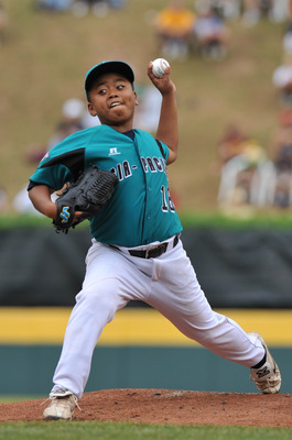 WILLIAMSPORT, PA - AUGUST 27: Starting pitcher Chin Ou #18 of Asia Pacific (Chinese Taipei) VERB against  the Caribbean (Curacao) in the international semifinal at Lamade Stadium on August 27, 2009 in Williamsport, Pennsylvania.  Asia Pacific (Chinese Tai