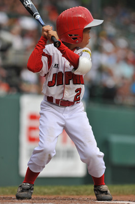 WILLIAMSPORT, PA - AUGUST 26: Shortstop Kenya Kawashima #2 of Chiba City, Japan bats against Reynosa, Mexico in the international semifinal at Lamade Stadium on August 26, 2009 in Williamsport, Pennsylvania. Reynosa, Mexico defeated Chiba City,  Japan 6-0