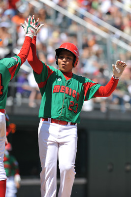 WILLIAMSPORT, PA - AUGUST 30: Third baseman Raymundo Berronnes #23 of Mexico (Reynosa) celebrates his game winning home run against Texas (San Antonio) in the consolation game at Volunteer Stadium on August 30, 2009 in Williamsport, Pennsylvania. Mexico d