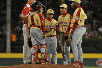 WILLIAMSPORT, PA - AUGUST 27: Shortstop Blake Jackson #3 and his teammates confer at the mound after being scored upon by the Southeast (Georgia) during the game against the West (California)  in the US semifinal at Lamade Stadium on August 27, 2009 in Wi