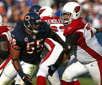 CHICAGO - NOVEMBER 08: Lance Briggs #55 of the Chicago Bears breaks away from a block attempt by Deuce Lutui #76 of the Arizona Cardinals at Soldier Field on November 8, 2009 in Chicago, Illinois. The Cardinals defeated the Bears 41-21. (Photo by Jonathan