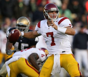 SOUTH BEND, IN - OCTOBER 17: Matt Barkley #7 of the USC Trojans at Notre Dame Stadium looks for a receiver against the Notre Dame Fighting Irish on October 17, 2009 in South Bend, Indiana. USC defeated Notre Dame 34-27. (Photo by Jonathan Daniel/Getty Ima