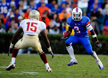 GAINESVILLE, FL - NOVEMBER 28:  Chris Rainey #3 of the Florida Gators attempts to run past Ochuko Jenije #15 of the Florida State Seminoles at Ben Hill Griffin Stadium on November 28, 2009 in Gainesville, Florida.  (Photo by Sam Greenwood/Getty Images)