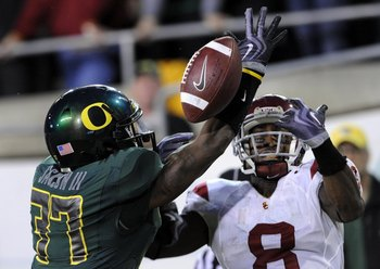 EUGENE, OR - OCTOBER 31:  Cornerback Talmadge Jackson III of the Oregon Ducks breaks up a pass in the end zone intended for wide receiver Ronald Johnson #8 Of the USC Trojans in the second quarter of the game at Autzen Stadium on October 31, 2009 in Eugen
