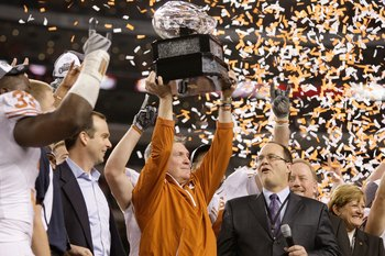 ARLINGTON, TX - DECEMBER 5: Head coach Mack Brown of the Texas Longhorns lifts the trophy after his teams 10-6 victory over the Nebraska Cornhuskers in the game at Cowboys Stadium on December 5, 2009 in Arlington, Texas. (Photo by Jamie Squire/Getty Image