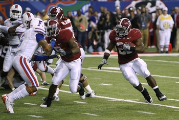 ATLANTA - DECEMBER 5:  Mark Ingram #22 of the Alabama Crimson Tide runs for a 3-yard rushing touchdown in the second quarter against the Florida Gators during the SEC Championship game at Georgia Dome on December 5, 2009 in Atlanta, Georgia.  (Photo by Ch