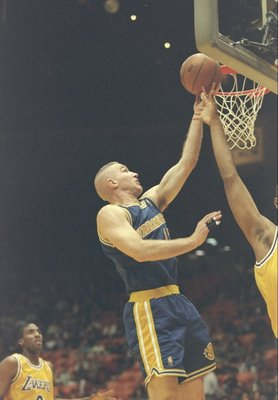 24 Jan 1997:  Forward Chris Mullin of the Golden State Warriors lays up the ball during a game against the Los Angeles Lakers at the Great Western Forum in Inglewood, California.  The Lakers won the game 114-97.   Mandatory Credit: Jed Jacobsohn  /Allspor