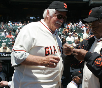 SAN FRANCISCO - JUNE 24:  Hall of Fame San Francisco Giants Gaylord Perry (L) and Willie Mays admire a pin commemorating the 1962 World series between the Giants and the New York Yankees before the San Francisco Giants 7-2 defeat of the New York Yankees a