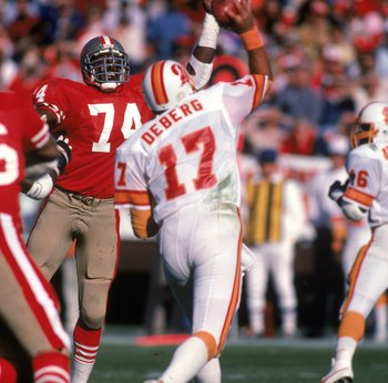 SAN FRANCISCO - NOVEMBER 18:  Defensive end Fred Dean #74 of the San Francisco 49ers raises his arm in an attempt to block a pass from Tampa Bay Buccaneers quarterback Steve DeBerg #17 during a game at Candlestick Park on November 18, 1984 in San Francisc