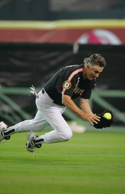 HOUSTON - JULY 11:  Rollie Fingers, Hall of Fame pitcher who played with the Oakland A's and San Diego Padres catches a fly ball during the Major League Baseball Legends and Celebrity Softball Game at Minute Maid Park on July 11, 2004 in Houston, Texas. (