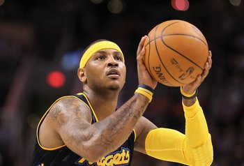 PHOENIX - APRIL 13:  Carmelo Anthony #15 of the Denver Nuggets shoots a free throw shot during the NBA game against the Phoenix Suns at US Airways Center on April 13, 2010 in Phoenix, Arizona. The Suns defeated the Nuggets 123-101.  NOTE TO USER: User exp