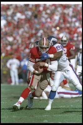 15 Jan 1994:  Tight end Brent Jones of the San Francisco 49ers gets tackled during a playoff game against the New York Giants at Candlestick Park in San Francisco, California.  The 49ers won the game, 44-3. Mandatory Credit: Mike Powell  /Allsport
