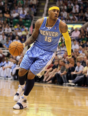 SALT LAKE CITY - APRIL 25:  Carmelo Anthony #15 of the Denver Nuggets dribbles the ball against the Utah Jazz during  Game Four of the Western Conference Quarterfinals of the 2010 NBA Playoffs at EnergySolutions Arena on April 25, 2010 in Salt Lake City,