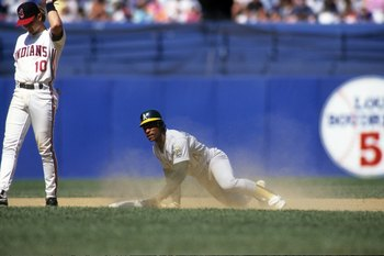 CLEVELAND - MAY 1991:  Rickey Henderson #24 of the Oakland Athletics slides to second base during their MLB game against the Cleveland Indians circa May 1991 at Cleveland Municipal Stadium in Cleveland, Ohio. (Photo by Rick Stewart/Getty Images)
