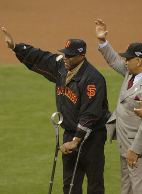 SAN FRANCISCO - OCTOBER 22:  Old time Giant Willie McCovey waves to the crowd before other former Giants Willie Mays throws out the ceremonial first pitch prior to the start of game three between the Anaheim Angels and the San Francisco Giants in the Worl