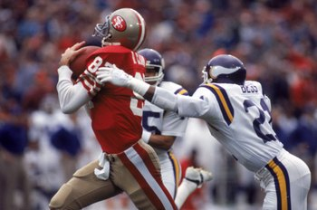 SAN FRANCISCO - DECEMBER 8:  Wide receiver Dwight Clark #87 of the San Francisco 49ers catches a pass against defensive back Rufus Bess #21 of the Minnesota Vikings during a game at Candlestick Park on December 8, 1984 in San Francisco, California.  The 4